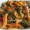 Pasta with vegetables in a creamy peanut sauce